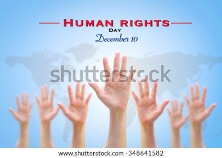 International Human Rights Day: December 10th conceptual idea: Many people blur hands raising upward on blue sky background w/ world map showing participation in social, economic, politic areas   - stock photo