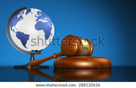 International law systems, justice, human rights and global business education concept with world map on a school globe and a gavel on a desk on blue background. - stock photo