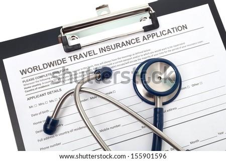 International travel medical insurance application with stethoscope - stock photo