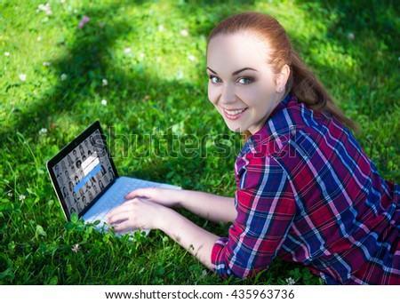 internet access concept - happy teenage girl lying with laptop on grass in summer park - stock photo