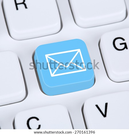 Internet concept sending E-Mail or email on computer keyboard with letter symbol - stock photo