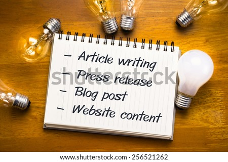 Internet content fields on notebook with many light bulbs - stock photo