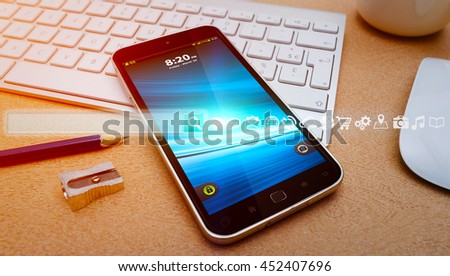 Internet icons and web bar over mobile phone in modern office - stock photo