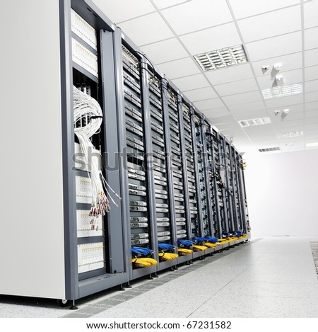internet network server room with computers racks and digital receiver for digital tv