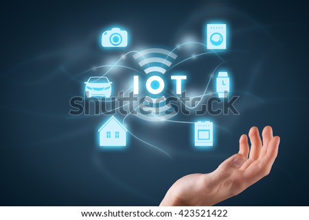 Internet of things (IoT) concept. Businessman offer IoT solution represented by symbol connected with icons of typical IoT â?? intelligent house, car, camera, watch, washing machine and cooker.