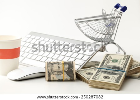 Internet online shopping concept with computer and cart - stock photo