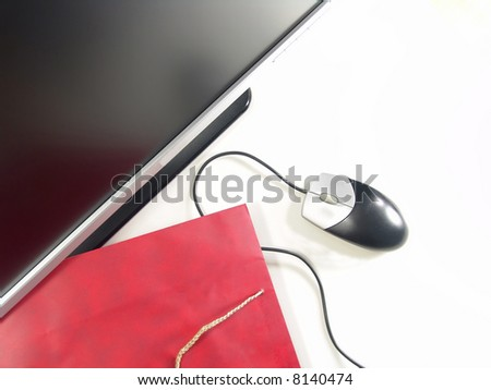 Internet Online Shopping - Wide Screen LCD Computer Monitor, Mouse and Gift bag (Isolated on white background) - stock photo