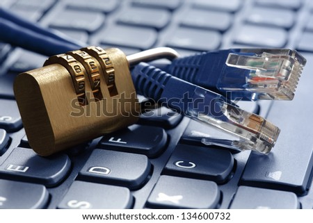Internet security and network protection concept, padlock and connection plug on laptop - stock photo