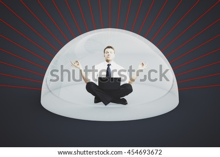 Internet security concept. Businessman with laptop meditating under shield attacked by red laser rays on dark background. 3D Rendering - stock photo