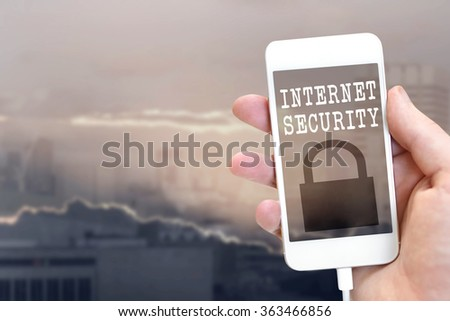Internet security lock at the phone screen isolated on blurry background - stock photo