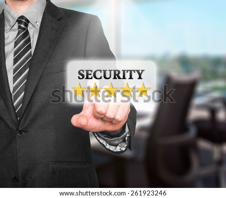 Internet security online business concept businessman pointing five stars security  services. Isolated on office background. Stock Photo   - stock photo