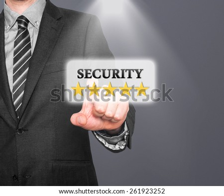 Internet security online business concept businessman pointing five stars security  services. Isolated on grey background. Stock Photo   - stock photo