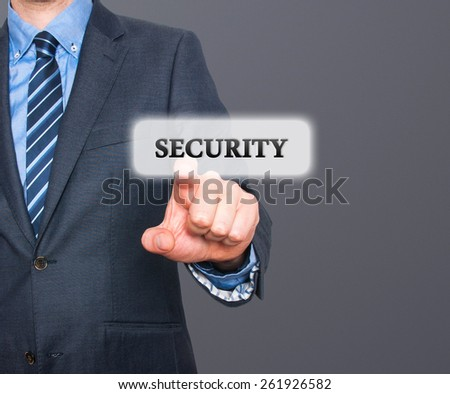 Internet security online business concept businessman pointing security services. Isolated on grey background. Stock Photo - stock photo