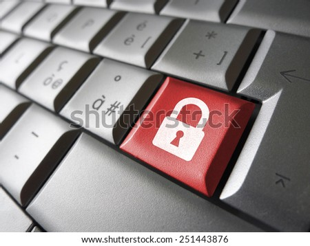 Internet, web and computer data security concept with padlock icon and symbol on a red laptop key for website and online business. - stock photo
