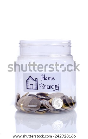 Interpretation of home financing by using coin in the jar  - stock photo