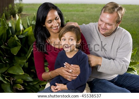Interracial family - Indian mother, Caucasian father and cute 5 year old little boy - stock photo