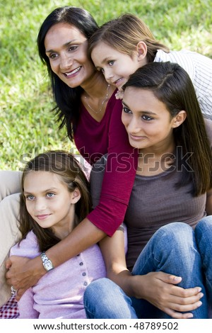Interracial family portrait, Indian mother with three mixed-race children - stock photo