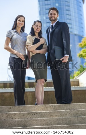 Interracial group of business men & women, businessmen and businesswomen team, Asian and caucasian male and female - stock photo