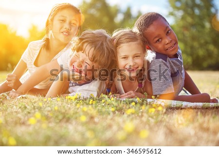 Interracial group of children in summer having fun and smiling
