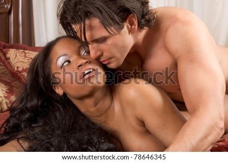 Interracial Lovers - sensual heterosexual couple making love. African-American black woman and Caucasian man - stock photo