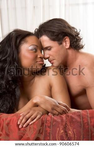 Interracial Lovers - sensual heterosexual couple making love. African-American black woman and Caucasian man - stock photo