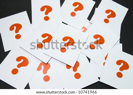 interrogation sign in red and white paper - stock photo
