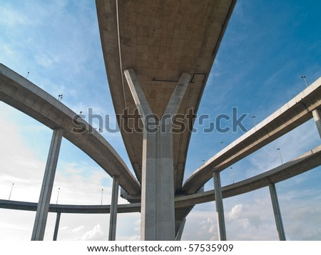 Intersection expressway with grade separation on blue sky - stock photo