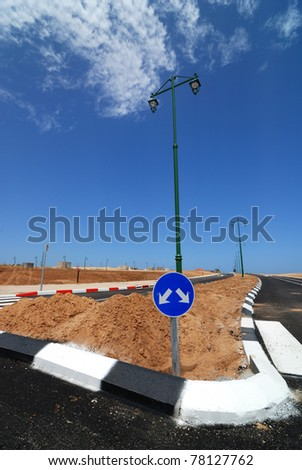 Intersection sign closeup at new city district - stock photo