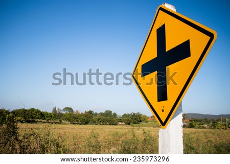 Intersection warning sign. - stock photo