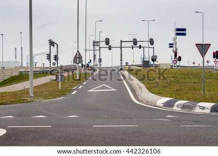 Intersection with traffic signs and separated bike lane - stock photo