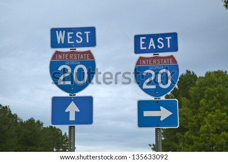 Interstate 20 Highway Signs going East and West in Southeast USA and Georgia - stock photo