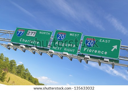 Interstate Highway Signs to Florence and Augusta Georgia at Intersection of Interstate 20 and 77 in Southeast of USA - stock photo