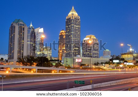 Interstate 85 runs below the skyline of Midtown Atlanta, Georgia, USA. - stock photo