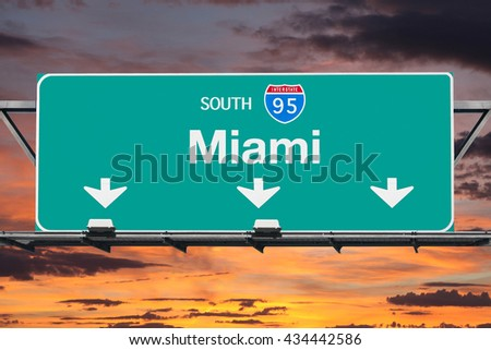 Interstate 95 south to Miami highway sign with sunrise sky. - stock photo