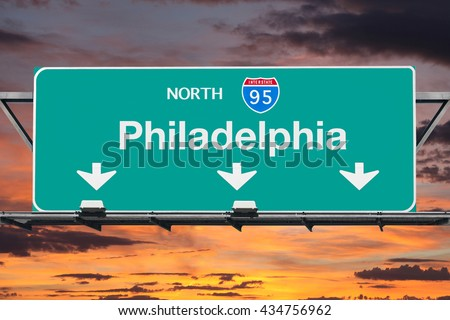 Interstate 95 south to Philadelphia highway sign with sunrise sky. - stock photo