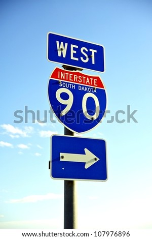 Interstate 90 West HIghway Sign. U.S.A. Vertical Photo. Transportation Theme. - stock photo