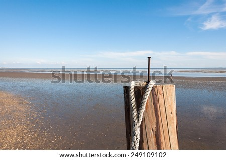 Intertidal Zone at the Hallig Langeness. In the background mainland, north Germany. Hallig Langeness is located in the wadden Sea in the north of Germany - stock photo