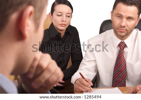interview, business meeting of three persons - stock photo