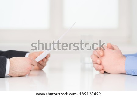 Interview. Close-up of two businesswoman around the table during job interview