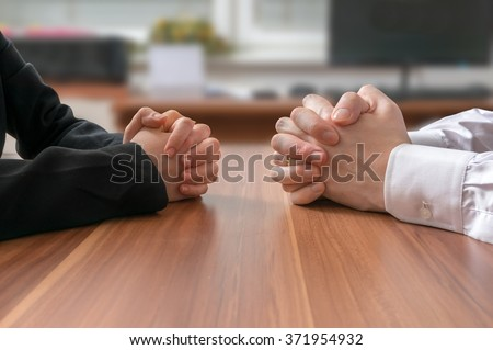 Interview or dialogue between politicians. Negotiation of two statesman with clasped hands in office. - stock photo