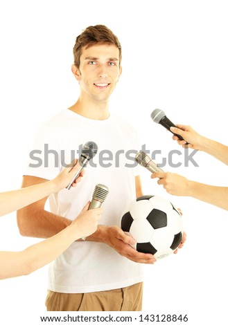 Interview with a young soccer player, isolated on white - stock photo