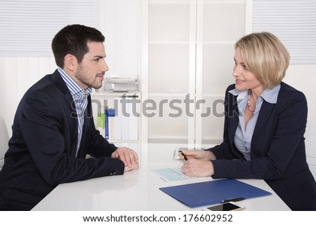 Interview with manager and young attractive man at office.