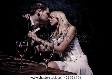 intimate moments, studio dark background - stock photo