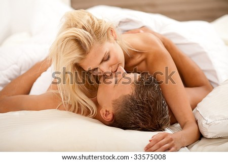 Intimate newlywed couple during the act of sex - stock photo