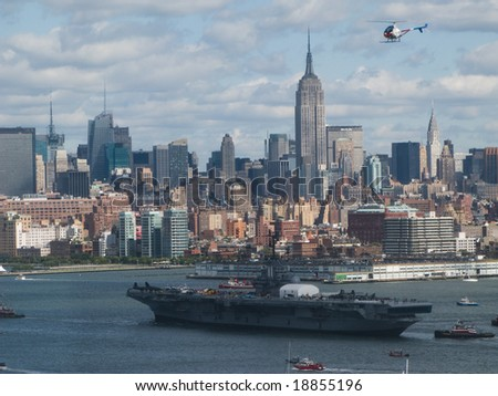 Intrepid arriving from docks - stock photo