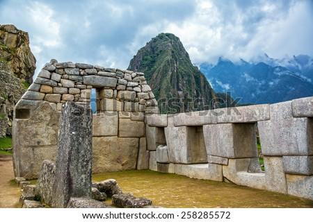 Intricate Incan stonework at Machu Picchu, Peru - stock photo