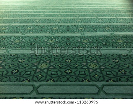 Intricate praying mat in a mosque - stock photo