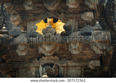 Intricately carved facade of Goa Lawah Bat Cave Temple, including dramatic, stylized sculptures of bats, in Bali, Indonesia. - stock photo