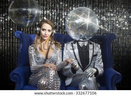 introducing mr and mrs discoball. two cool club characters dance and pose in a nightclub setting