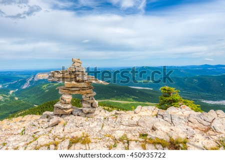 Inukshuk on the top of Sunrise Hill, Powderface Ridge, Kananaskis Country Alberta Canada - stock photo